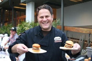 The internet has A LOT of pictures of Adam Fleischman holding hamburgers.